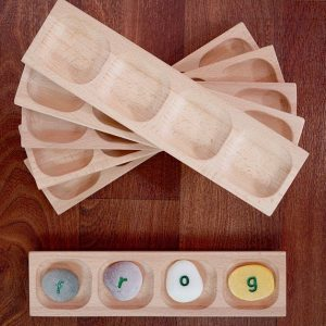 words,letters,sounds,alphabet,wooden tray,tactile learning,pebbles,stones